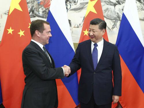 境外媒体:俄总理访华推动全方位合作 盛赞中俄关系