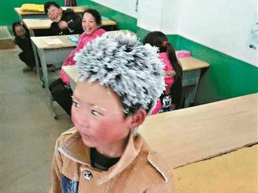 """西媒:""""冰花男孩""""刺痛人心 中国留守儿童急需更多关爱"""
