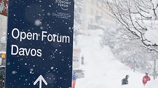 达沃斯大雪迎年会 给当地交通造成影响