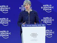 英国首相支持自由贸易和全球规则体系