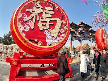 """外媒:""""反向团圆""""渐成中国人春节团聚新形式"""