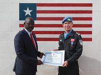 利比里亚授予中国维和警察防暴队国家奖