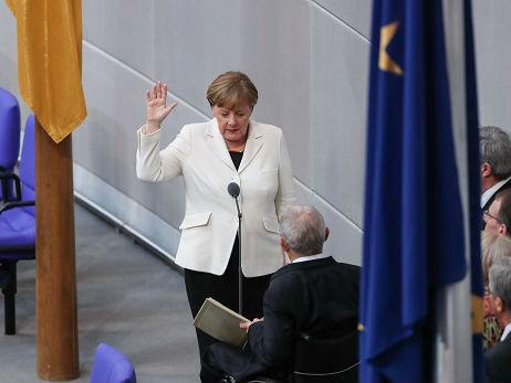 法媒:默克尔再度当选总理 将赴法讨论欧洲改革问题