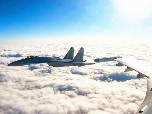 境外媒体关注中国战机成体系赴西太南海远训