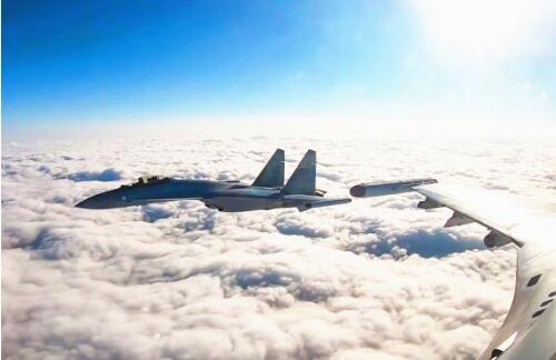 大地彩票app:境外媒体关注中国战机成体系赴西太南海远训