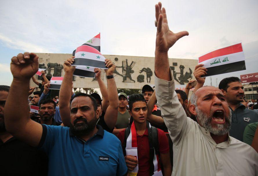 伊拉克民众集会抗议美英法空袭叙利亚
