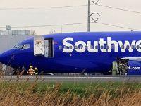 美国客机空中引擎爆炸 乘客被吸出机外