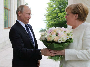 德法领导人先后访俄!外媒称美退出伊核协议给普京带来好运
