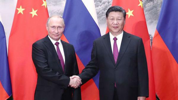 """外媒关注习近平向普京颁授""""友谊勋章"""""""
