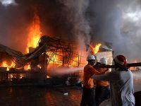 巴基斯坦首都伊斯兰堡集市发生火灾 至少150间商铺被烧毁