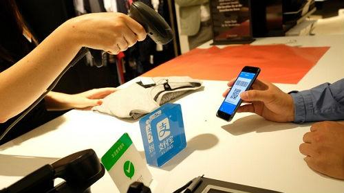 港媒:內地移動支付熱潮吹向香港 但改變消費習慣尚需時日