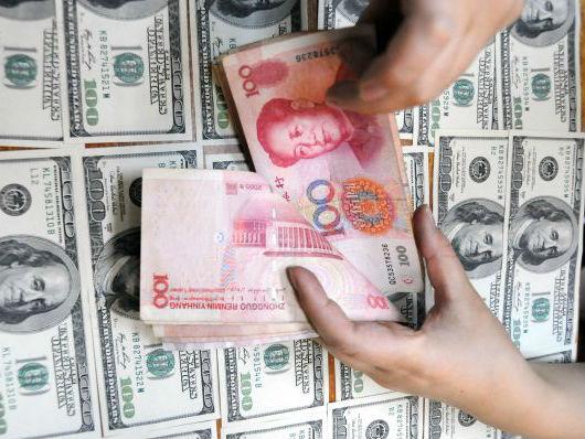 """英媒:中国外汇储备迎来""""两连升"""" 跨境资金流动形势好于预期"""