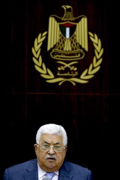 9月15日,在约旦河西岸城市拉姆安拉,巴勒斯坦总统阿巴斯主持会议。巴勒斯坦总统阿巴斯15日说,巴方准备将贝都因人居住区、阿克萨清真寺等涉及以色列的问题提交国际法院。新华社/法新