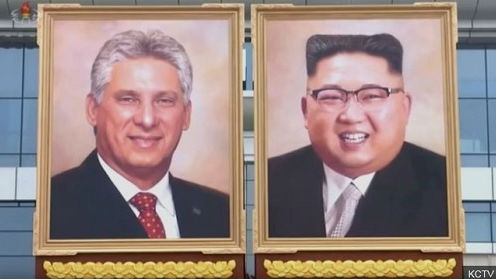 法媒:朝鲜公开场合首次出现金正恩肖像画