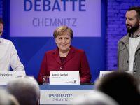 默克尔:德国应更多从源头解决难民问题