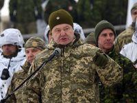 俄乌辩论晋级 乌总统观察军演称:枪挂墙上早晚要射击
