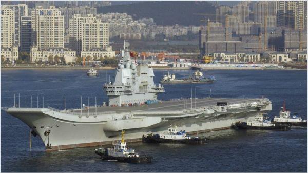 港媒猜测首艘国产航母将入列 或参加今年海军节阅舰式