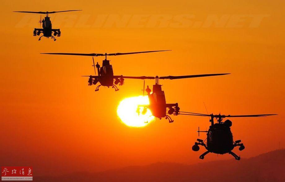近日,网上放出一组美、俄等多国军队军用直升机出动高清图,共同的特点都是在霞光中出动,颇有意境。图为美制AH-1S武直与德制BO-105直升机组成的联合编队。23