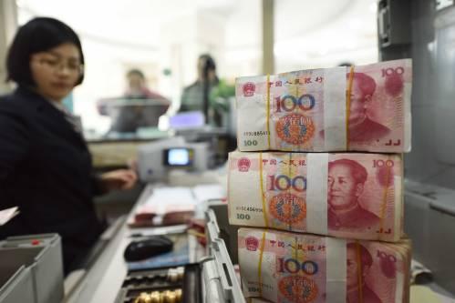 """外媒分析:中国有足够""""子弹""""稳定人民币汇率"""