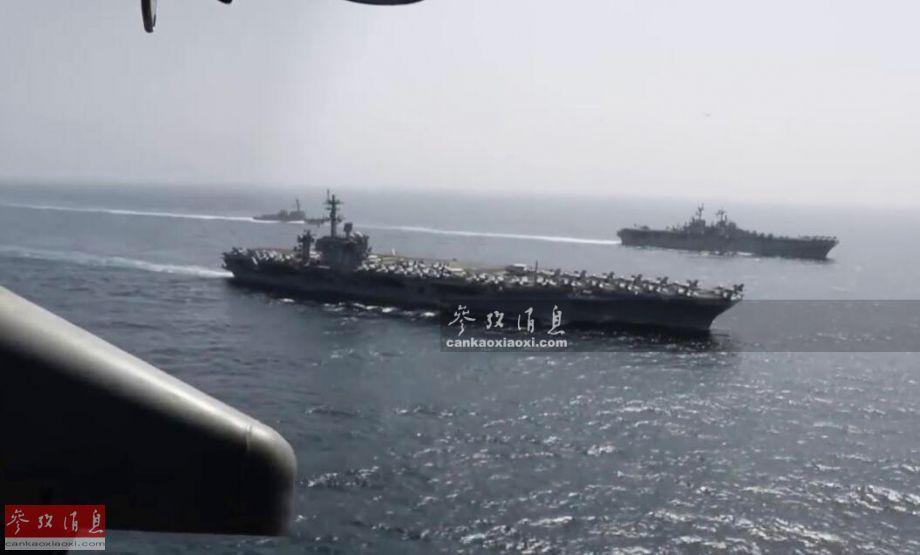 """5月19日,美海军""""林肯""""号(CVN-72)核动力航母与""""奇尔沙治""""号(LHD-3)两栖攻击舰组成""""双航母""""编队进入波斯湾演练,威慑伊朗意味明显。图为美军直升机航拍的""""双航母""""编队视频截图。50"""