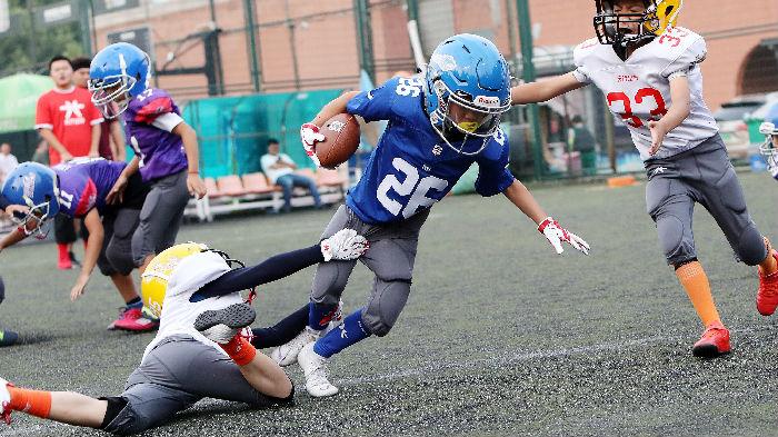 法媒称橄榄球运动努力在中国扎根:它有种吸引人的魔力