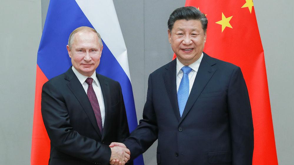 境外媒体关注中俄元首互致新年贺电