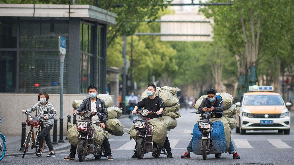 外媒关注武汉订正新冠确诊病亡数据