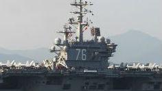 外媒述评:美两航母南海演习炫耀武力 中国不惧美方恐吓施压