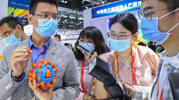 外媒关注中国国产新冠疫苗开放预约接种