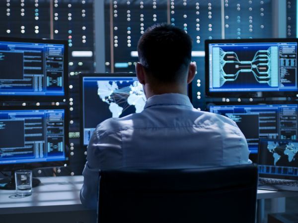 system-security-specialist-working-at-system-control-center--room-is-full-of-screens-displaying-various-information--808157766-96bc39cdf2ae486c8f6127287b798bda