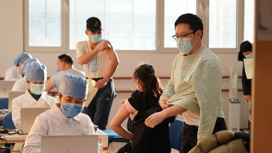 外媒关注北京7万余人接种新冠疫苗
