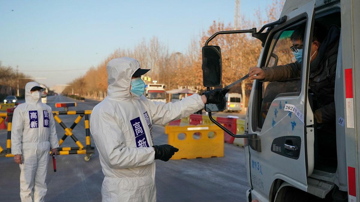 外媒:中国升级疫情防控应对春运潮